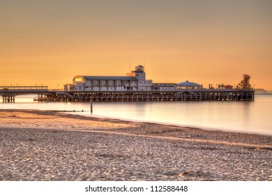 Sunrise on Bournemouth Beach with the Pier in the background.