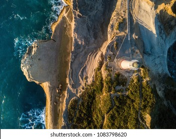 Sunrise on Castle Point from drone with lighthouse, New Zealand