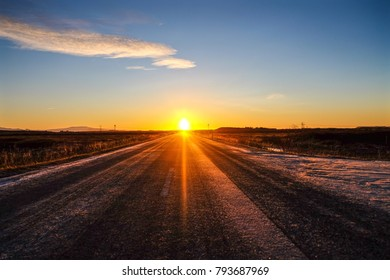 Sunrise on the country road in winter.