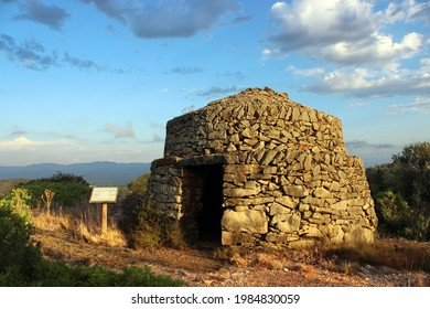 Sunrise on the dry stone construction of Barraca de Quicolis at la Serreta de Freginals in Montsia, Catalonia, Spain