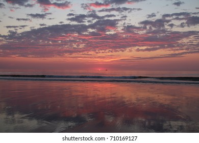 Sunrise on an East Coast Beach - Pink and Purple Clouds - Partly Cloudy Sky - Waves