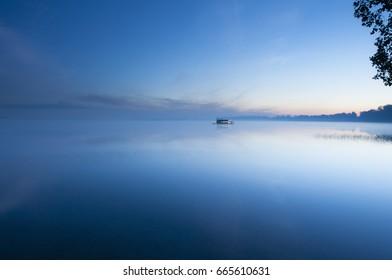 Sunrise on a Floating Sauna (Boat on a lake)