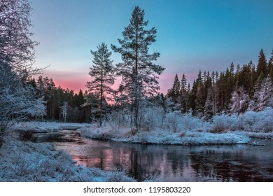 Sunrise on a freezing winter day in magical colors / Sweden