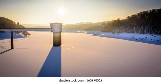 "Sunrise on the frozen lake of the ""La Gileppe"" dam."