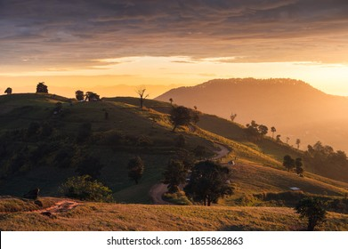 Sunrise on hill and tourists camping on vacation in national park at Doi Mae Tho, Chiang Mai