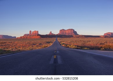 Sunrise on Monument Valley and the famous road leading to it