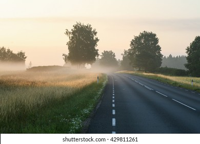 Sunrise on the motorway on a foggy countryside morning