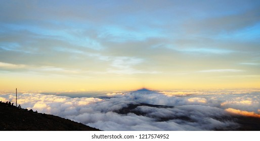 Sunrise on mount teide, sun rises behind the mountain so you see the shadow of the peak. Teide is Spain's highest mountain. Tenerife, Canaries.