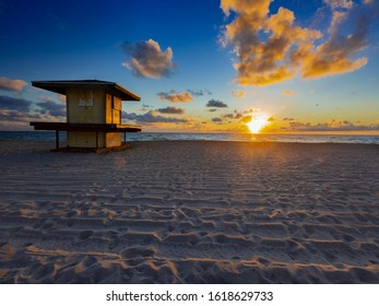 Sunrise on old Lifeguard Tower at Hollywood Beach FL.