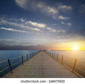 sunrise on the pier dawn on a pier in the Red Sea. Africa