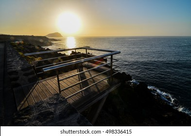 Sunrise on a Pier over Atlantic Ocean in Tenerife Canary Islands Spain
