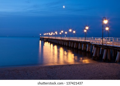 Sunrise on the pier at the seaside, Gdynia Orlowo, Poland. Long exposure photography