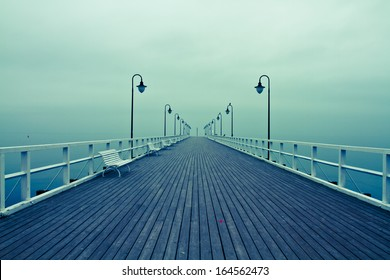 Sunrise on the pier at the seaside, Gdynia Orlowo, Poland. Autumn by the sea