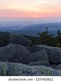 Sunrise on a rocky cliff in the harz mountains