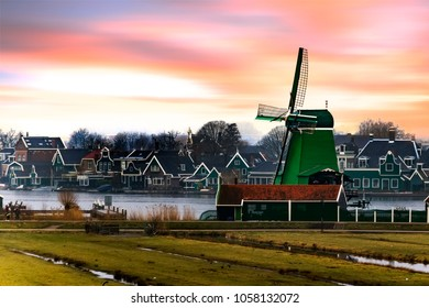 Sunrise on the sawmill at the river side in Zaanse Schans, Netherlands