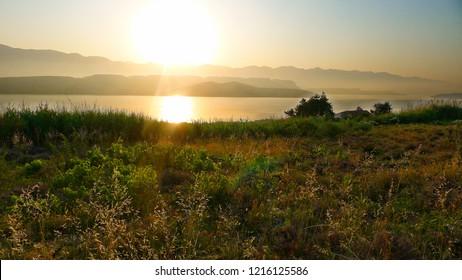 sunrise on the sea coast of the island of Pag in the background of the Velebit mountain, Croatia