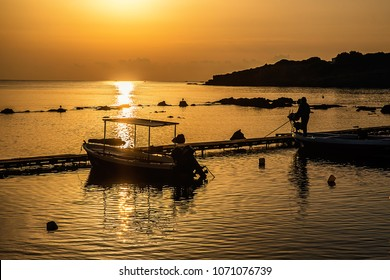 Sunrise on the sea and a small fishing boat
