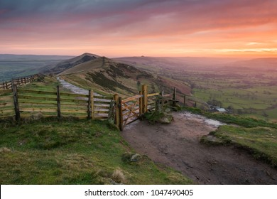 Sunrise on the slopes of the great ridge. With a view from the iconic gate all the way along the ridge line to the summit of Win Hill on the horizon.