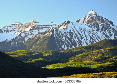 Sunrise on Snowy Mountain and Aspen Forest.  Mt Sneffles, Rocky Mountains, Colorado