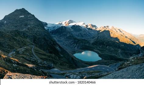 Sunrise on Sustenpass with Steingletcher and Steinsee, Switzerland, Europa. Sustenpass is a mountain pass in the Swiss Alps. Stein Glacier in Swiss alps in summer. Alpine Glow - Shutterstock ID 1820140466
