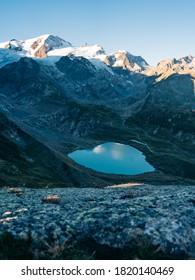 Sunrise on Sustenpass with Steingletcher and Steinsee, Switzerland, Europa. Sustenpass is a mountain pass in the Swiss Alps. Stein Glacier in Swiss alps in summer. Alpine Glow - Shutterstock ID 1820140469