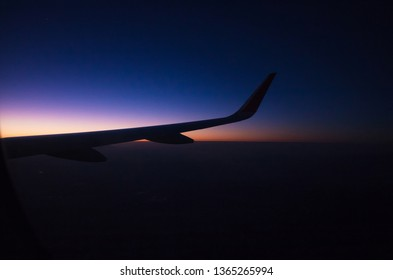 Sunrise on window plane wiew, with mountains on the background i