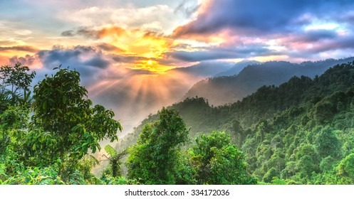 Sunrise on Yen Bai Heaven Gate peaks when the sun rises over the valley radiates ray with a bright yellow color to the highest forest area of Yen Bai, Vietnam