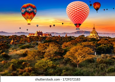 Sunrise over Bagan ruins with hot air balloons in the sky
