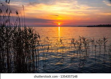 Sunrise over the Balaton lake, Hungary. Pastel morning colors of the lake and sky