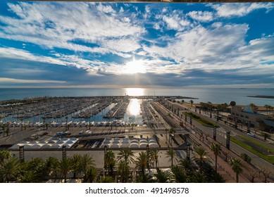Sunrise over Barcelona's port