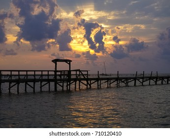 A Sunrise over the Bay with pier destruction in Rockport Texas after Hurricane Harvey
