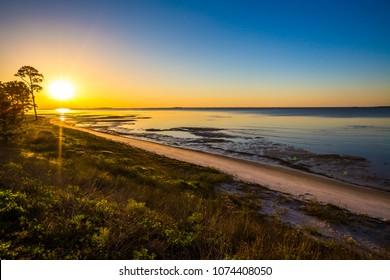 Sunrise over beach by Apalachicola, FL