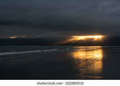 Sunrise over the beach in Nelson, New Zealand. Tahunanui Beach