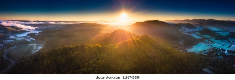 Sunrise over Bieszczady Mountains in Poland. Aerial panoramic landscape photographed from drone.