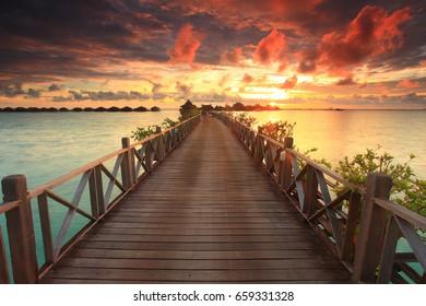 Sunrise over Borneo Islands, beautiful resort in Mabul. Soft focus and high iso