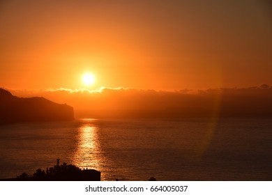 Sunrise over a calm ocean to the east of Funchal, Madeira