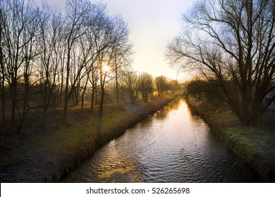 sunrise over a canal in Winter