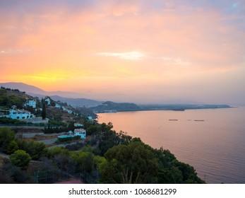 Sunrise over the Salobreña city coastline in Costa Tropical in Granada, Spain.