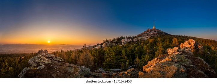 Sunrise over the city of Liberec, Czech republic. Jested. View from the Virive stones Jested Mountain. Jizerske mountains and Liberec. - Shutterstock ID 1571672458