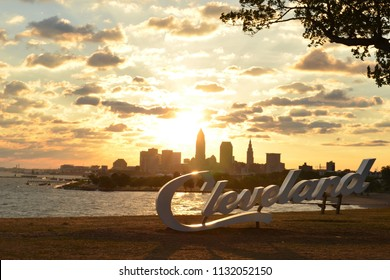 Sunrise over Cleveland script sign and skyline at Lake Erie Edgewater park