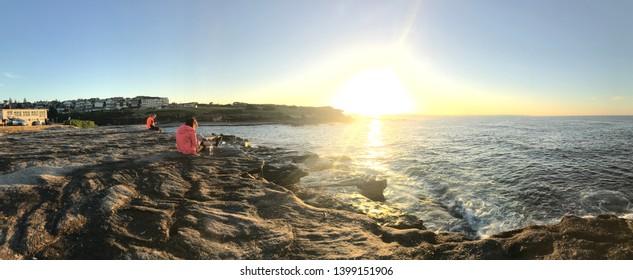 Sunrise over Clovelly Beach, Sydney, Australia at Rocky Outcrop