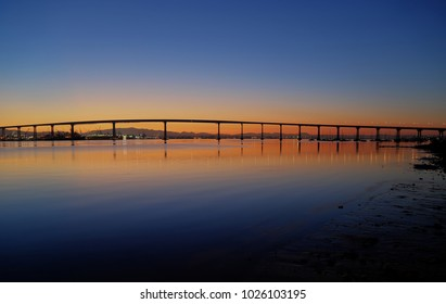 The Sunrise over the Coronado Bridge in San Diego, California.