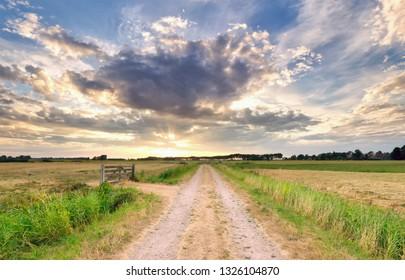 sunrise over countryside road in Dutch farmland, Netherlands