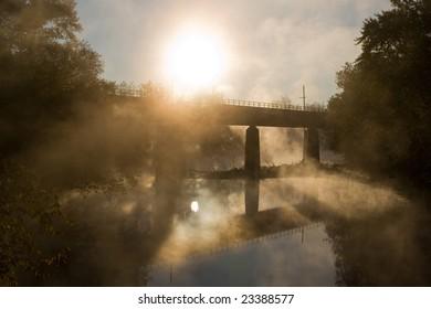 Sunrise over creek & bridge