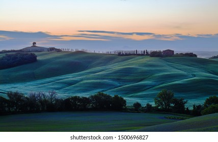 Sunrise over curvy hills in Tuscany, Italy