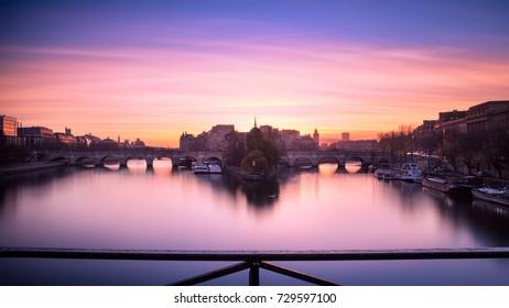 Sunrise over the Île de la Cité, Paris, France. View from the Pont des Arts
