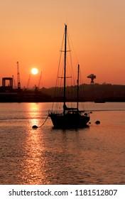 Sunrise over Devonport dockyard, Plymouth, Devon