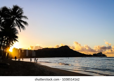 Sunrise over Diamond Head on Waikiki Beach on the Island of Oahu, Hawaii