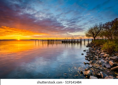 Sunrise over dock and the Chesapeake Bay, in Havre de Grace, Maryland.