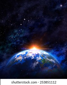 Sunrise over the Earth. Imaginary view of planet earth in outer space with the rising sun. Elements of this image furnished by NASA
